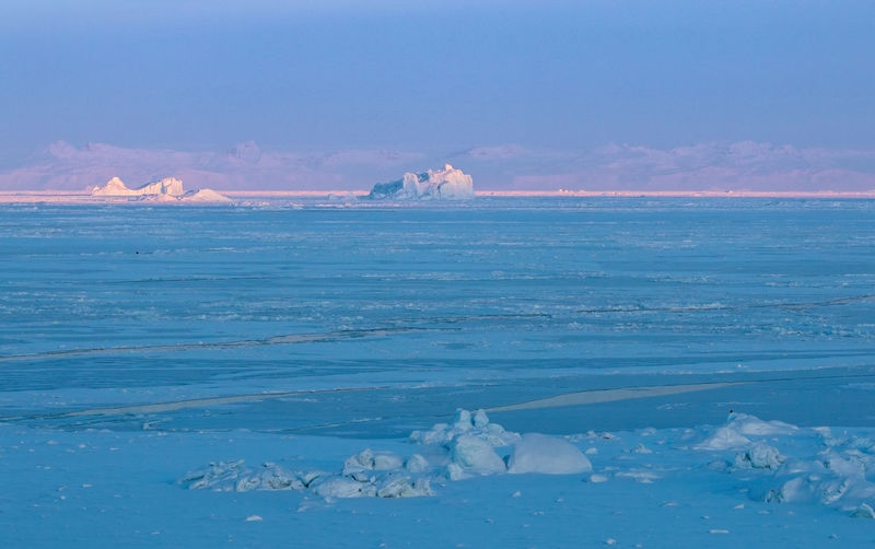 Water Scenics - Nature Sea Beauty In Nature Sky Tranquility Tranquil Scene Waterfront Nature Cold Temperature Winter Frozen Ice No People Cloud - Sky Idyllic Blue Non-urban Scene Land Ocean Iceberg Iceberg - Ice Formation Sunrise Winter Greenland