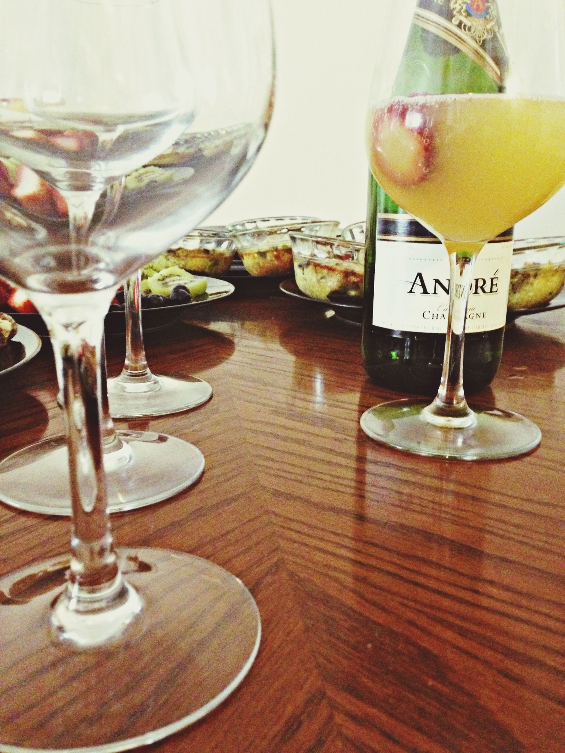 indoors, drink, table, food and drink, drinking glass, refreshment, glass - material, freshness, still life, wineglass, transparent, alcohol, close-up, restaurant, glass, vase, wine, bottle, jar, home interior