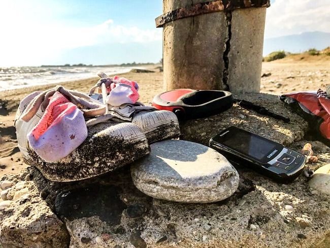 Beach Sand Day Outdoors Sea Sky No People Sand Pail And Shovel Water Shoes Socks Dogwalk Walking Telephone Old Complicated Kumsal Yürüyüş Gezinti Ayakkabı Telefon Lost In The Landscape Be. Ready.