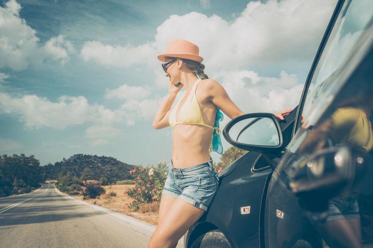 Full length of woman on road against sky