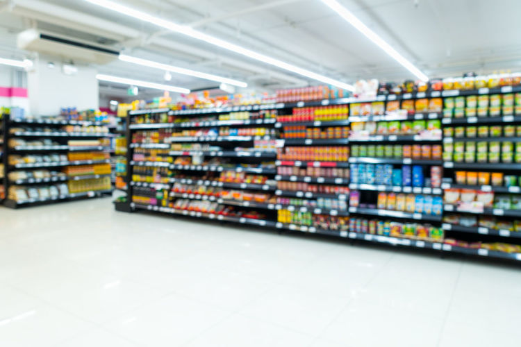Store shelf Business Department Store Goods Light Motion Blur Objects Sale Abstract Blur Choice Concept Consumerism Convienient Market Food Groceries Indoors  Large Group Of Objects Minimart Retail  Shelf Shop Shopping Mall Store Supermarket Variation