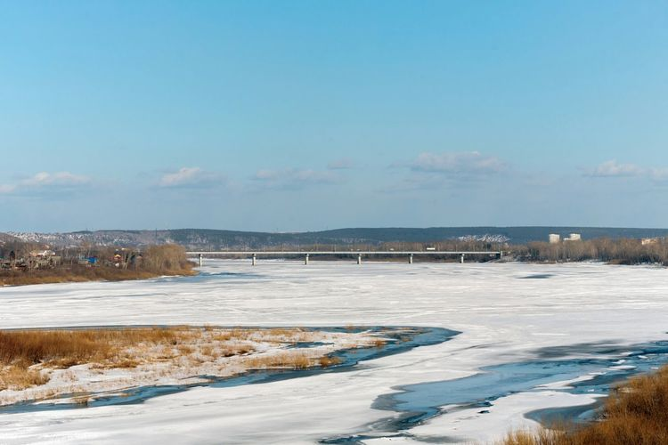 Bridge over the frozen river Tom. River River View Frozen River Bridge Kemerovo Siberia Russia Early Spring Sunlight Water Cold Temperature Blue Bridge - Man Made Structure Sky Landscape Horizon Over Water Frozen Water