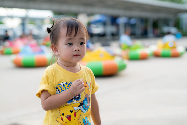 Childhood Cute Day Focus On Foreground Leisure Activity Looking At Camera Multi Colored One Person Outdoors People Portrait Real People Standing