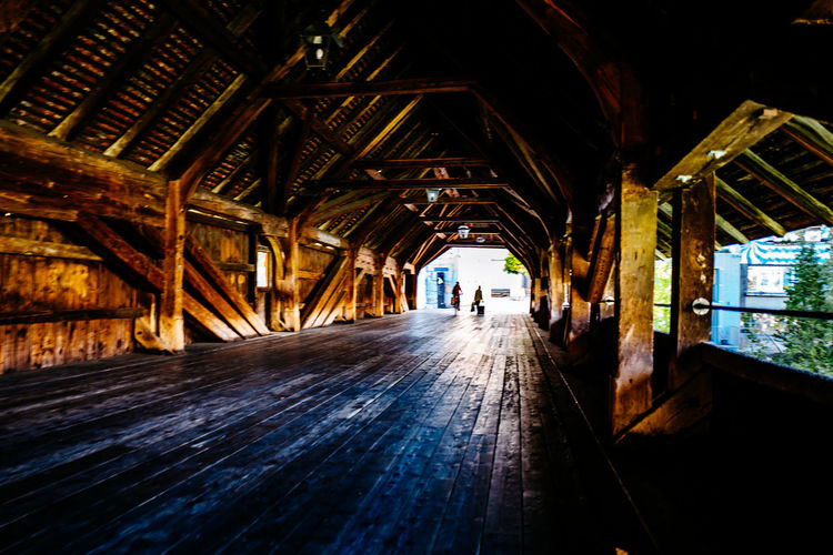 People in wooden tunnel