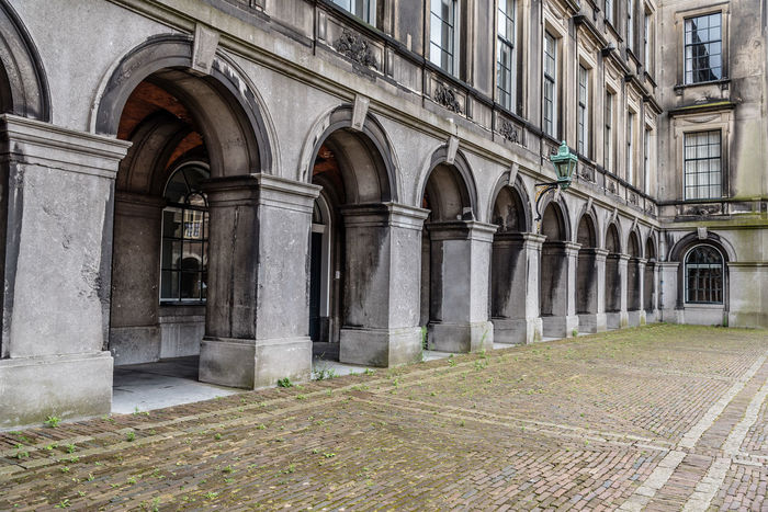 Cityscape of The Hague a cloudy day of summer Arch Architectural Column Architecture Binnenhof Building Building Exterior Built Structure City Cityscape Day History Landmark Netherlands No People Outdoors Parliament Parliament Building The Hague Travel Travel Destinations