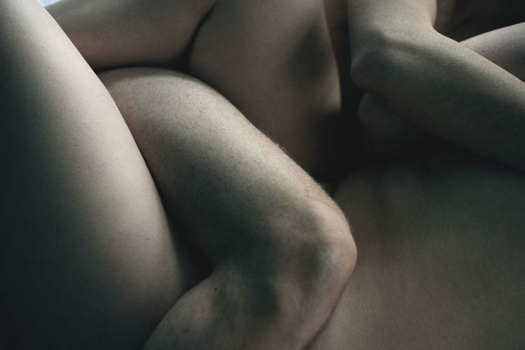 Midsection of naked couple