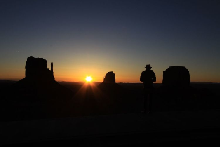 Monument Valley National Park Architecture Beauty In Nature Clear Sky Day Landscape Nature One Person Outdoors People Real People Scenics Silhouette Sky Sun Sunlight Sunset Tranquility Travel Destinations