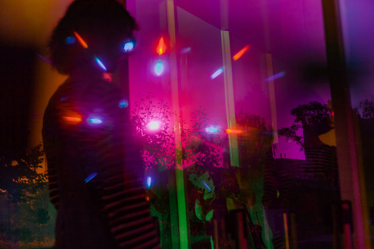 One Person Night Illuminated Adult Standing Music Nightlife Arts Culture And Entertainment Indoors  Mid Adult Nightclub Human Body Part Women Enjoyment Celebration Multi Colored Pink Color Human Limb