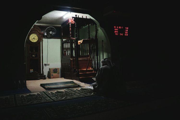 Illuminated machine at night