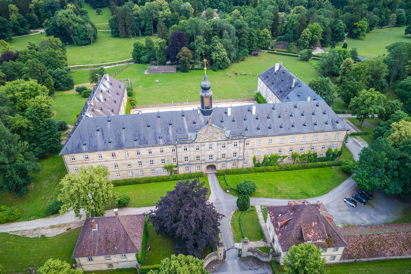 COBURG, GERMANY - CIRCA JUNE 2018: Air view of The The Tambach Palace alias Schloss Tambach in Coburg, Bavaria, Germany Architecture, Castle, Coburg, Editorial, Europe, European, Garden, Germany, Historic, Landmark, Old, Outdoors, Palace, Park, Plants, Stone, Street, Traditional, Travel, Urban Plant Tree Architecture Built Structure Building Exterior Green Color Grass Nature Building High Angle View The Past Garden Day History Formal Garden No People Mansion Travel Destinations Lawn Roof Outdoors Ornamental Garden Hedge