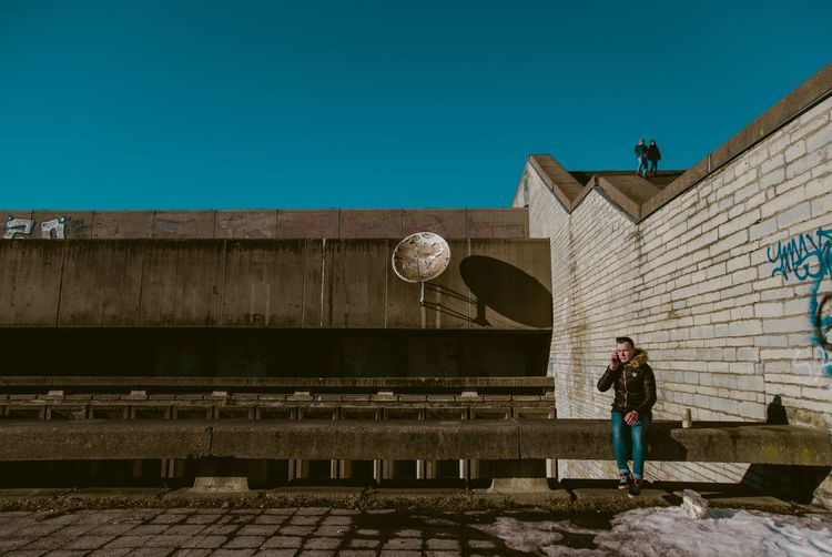 An abandoned Olympic stadium in Tallinn, Estonia Abandoned Buildings Abandoned Places Street Portrait Architecture And People Real People Street Photography Real People Architecture Clear Sky Building Exterior Built Structure Full Length Lifestyles Wall Sky Men One Person