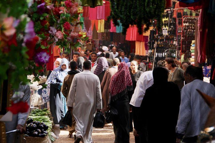 Crowd walking on street in market