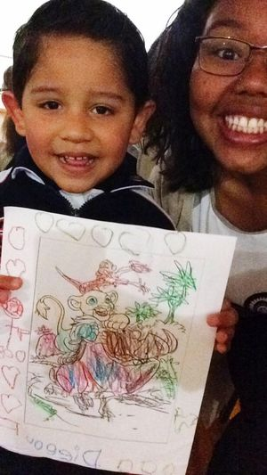Diego and his coloring sheet So Cute He's A G