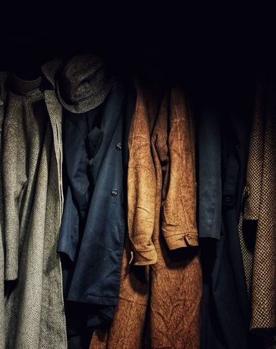 Clothes hanging in shelf