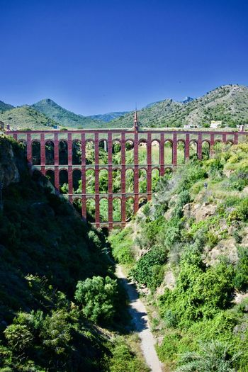 Eagle Aqueduct, Nerja Andalucía Aqueduct Irrigation Equipment Path Water Supply Ancient Civilization Arch Architectural Column Architecture Bridge Built Structure Connection Mountain Nature Neo-romanesque No People Plant Roman Sunlight The Way Forward Transportation Water