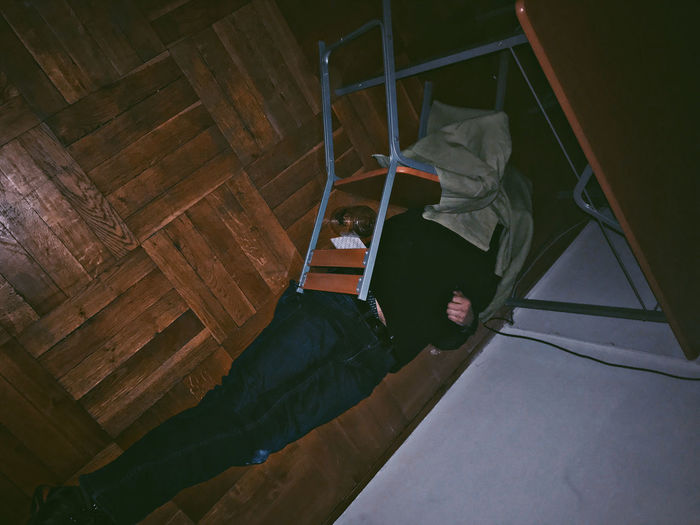 High angle view of man sitting on bed