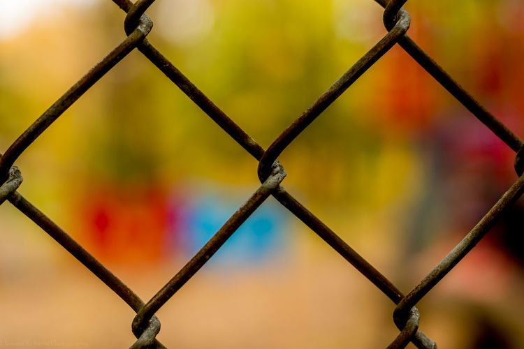 This is a photo with focus on foreground showing off a blurred background. Also shot at the same childhood playground. Backgrounds Blurred Background Chain Chainlink Fence Close-up Colors Day Daytime Dof EyeEm Gallery Focus On Foreground Full Frame Kids Metal Nature Nature No People Outdoors Pattern Playground Shapes And Forms Sky Sport This Week On Eyeem