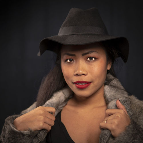 young Girl with black hat Fur Coat Black Hat Portrait Hat Looking At Camera Headshot Front View Clothing Indoors  Studio Shot Black Background One Person Young Adult Women Adult Young Women Lifestyles Beautiful Woman Leisure Activity Real People Human Face Contemplation Hairstyle
