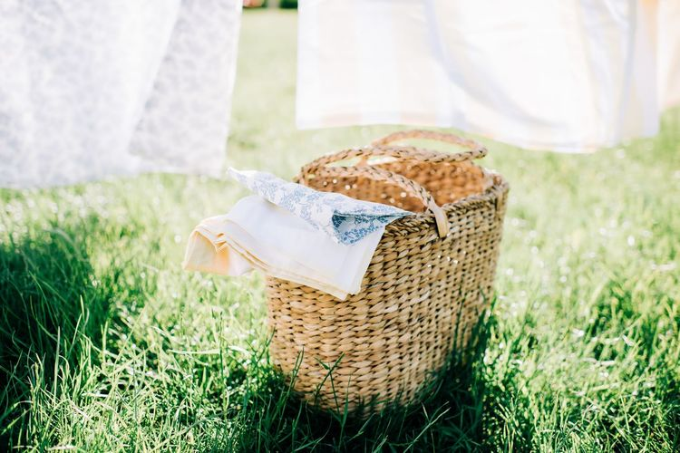 Close-up of bread in basket on field