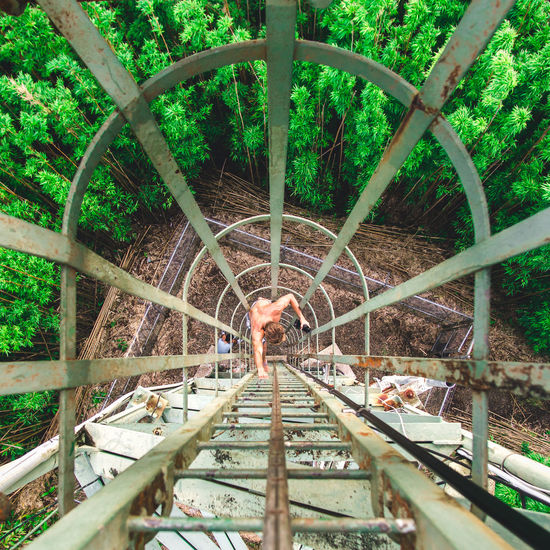 You have to look for the adventure. Adventure won't find you. Adventure Architecture Climbing Day Full Length Green High Angle View Ladder Leading Lines Leisure Activity Lifestyles Men Nature One Person Outdoors People Real People Rust Standing Tree Trees Water The Great Outdoors - 2017 EyeEm Awards Place Of Heart Done That. Lost In The Landscape