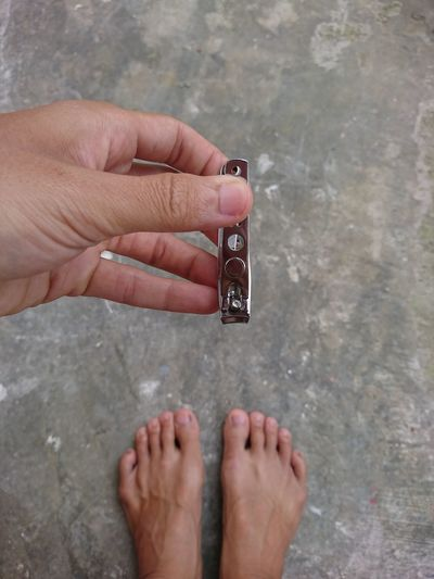 Close-up of person holding nail clipper