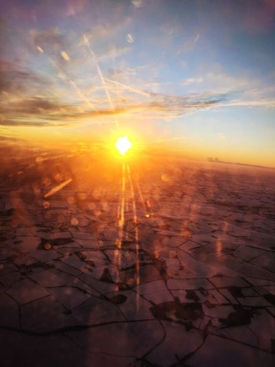 Snowy plane trip. Sunset Sun Sunlight Landscape Scenics Aerial View Airplane Beauty In Nature Snow ❄ Fields And Sky Sunlight Golden Glow Sun No People Window Mobile Phone Photography Illuminated Colours Of Nature Lovephotography  Outdoors Winter Snow