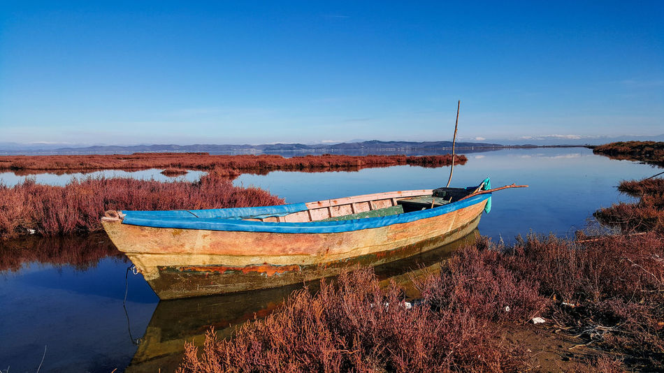 Nautical Vessel Water Sea Tranquility Blue Mode Of Transport No People Outdoors Nature Beach Sky Clear Sky Moored Day Scenics