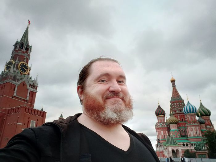 Portrait of man against buildings in city