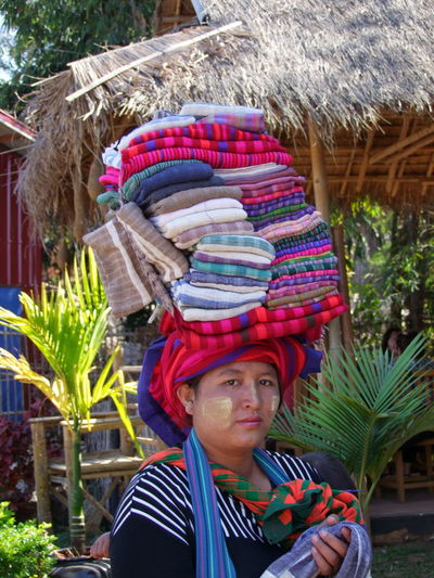 Shan Woman Trading Clothes Composition Ethnic Pride Full Frame Fun Happy Headshot Inle Lake Kakku Looking At Camera Making A Living Market My Selling Shan State Shan Woman Smiling Tourism Tourist Attraction  Tourist Destination Trader Traditional Clothes Woman Young Woman Young Woman Smiling