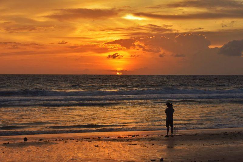 Sunset at karon beach Phuket Thailand Sunset Beach Sea Sky Land Water Beauty In Nature Horizon Over Water Horizon Orange Color Cloud - Sky Scenics - Nature Real People Nature Lifestyles Silhouette Tranquility Men Idyllic Outdoors