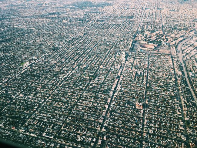 Flying over Los Angeles Aerial View City Built Structure Outdoors Landscape Building Exterior Architecture Day Rural Scene No People Cityscape Scenics Nature Patchwork Landscape Agriculture Beauty In Nature Geometry Geometric California Los Angeles, California Airplane
