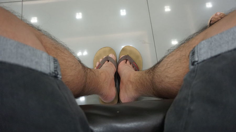 Real People Indoors  Human Body Part Men One Person Bathroom Body Part Human Leg Low Section Domestic Bathroom Relaxation Adult Leisure Activity Lifestyles Illuminated Personal Perspective Human Foot Selective Focus Bathtub
