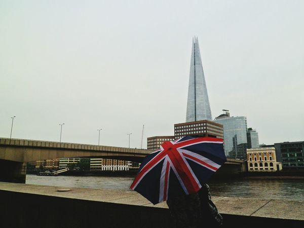 London Bridge and The Shard Architecture Famous Place Tall - High River Thames Standing On The Move Woman British Culture Union Jack Umbrella Adults Only Outdoors London Lifestyle International Landmark Capital Cities  Travel Destinations Bridge - Man Made Structure Built Structure Day London Tourism Incidental People Connection Travel The Shard London