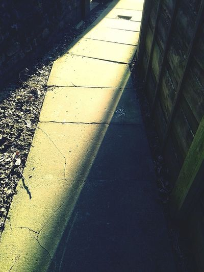 Cast Angled Shadows Of Fence Sunlight Through Gap Sunlit Pathway Bright Golden Sunlight Flag Stone Paving Stone Ginnel Shadow And Light On Paving Day Sunlight Outdoors No People Focus On Shadow The Week On EyeEm