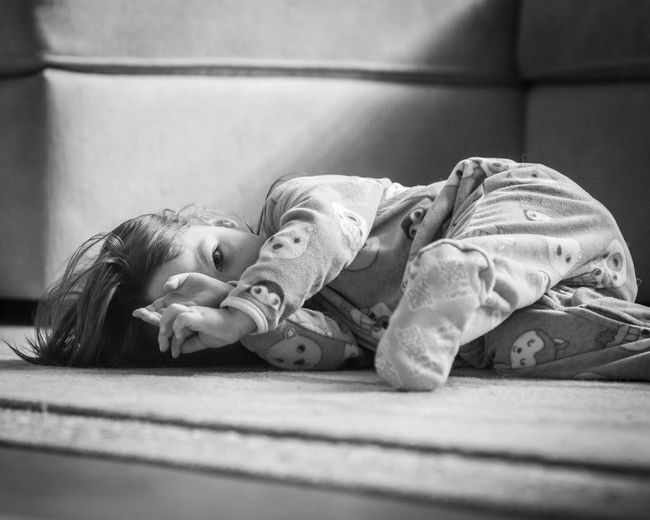 Portrait of girl lying on carpet