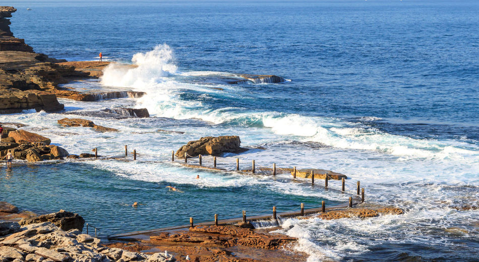 Mahon rock pool from a distance, with waves crashing into it Swimming Animal Themes Beauty In Nature Blue Crash Day Force Horizon Over Water Mahon Pool Mammal Motion Nature No People Outdoors Pool Power In Nature Rock Pools Scenics Sea Sky Swimming Pool Travel Destinations Water Wave