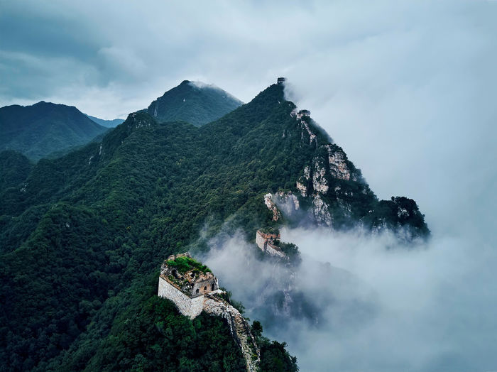 Great Of Wall China And Mountains Against Cloudy Sky