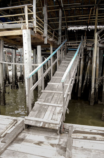 the wooden ramp use for walking up to the restaurant. Architecture Built Structure Column Nature No People Outdoors Pier Ramp Slope Up Slopeup SUPPORT The Way Forward Water Wood - Material
