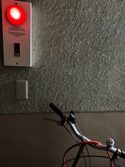 Close-up of bicycle on wall at home