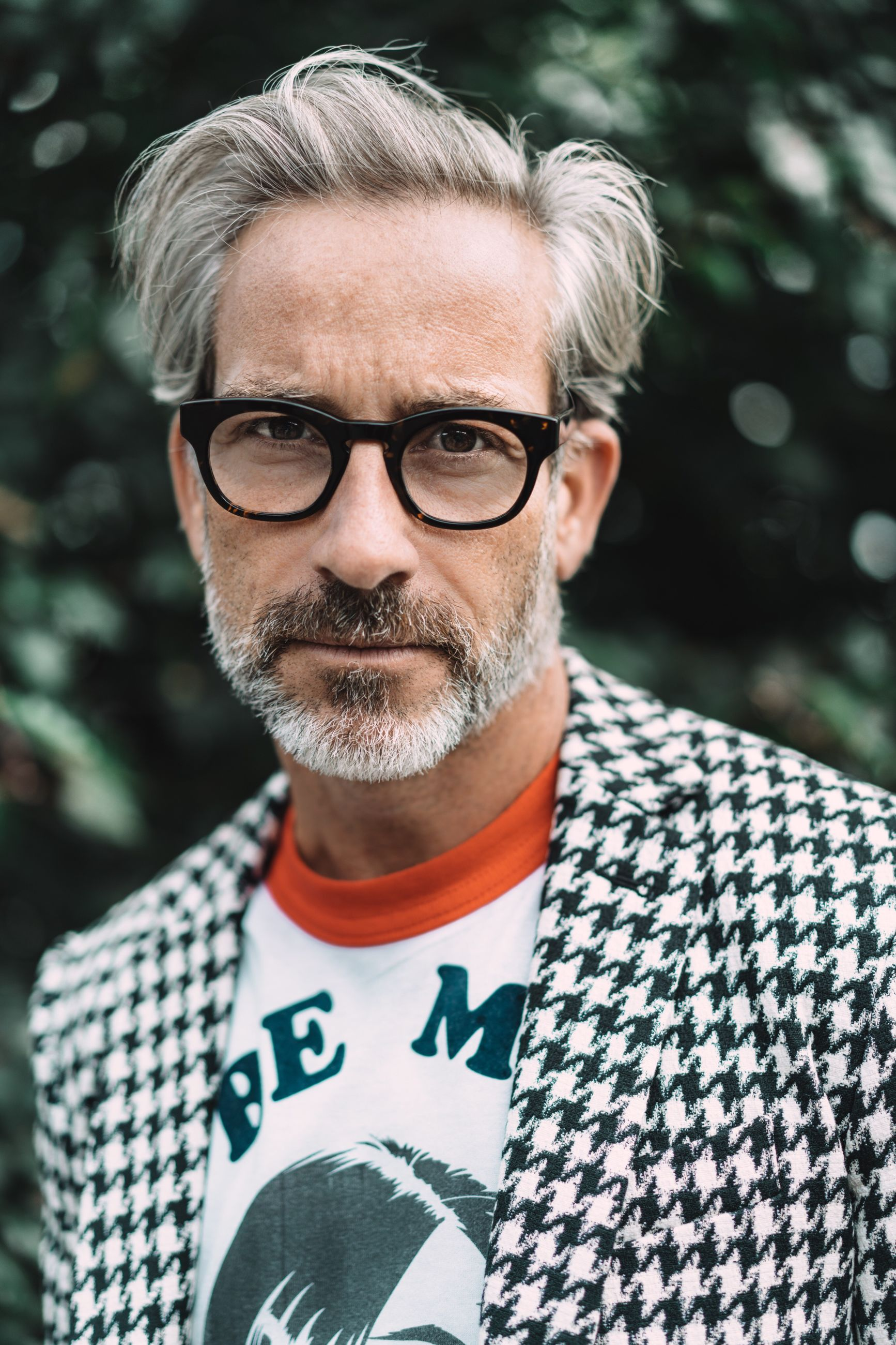 eyeglasses, real people, beard, front view, casual clothing, focus on foreground, mature adult, looking at camera, mature men, portrait, lifestyles, one person, outdoors, senior adult, day, leisure activity, gray hair, close-up, young adult