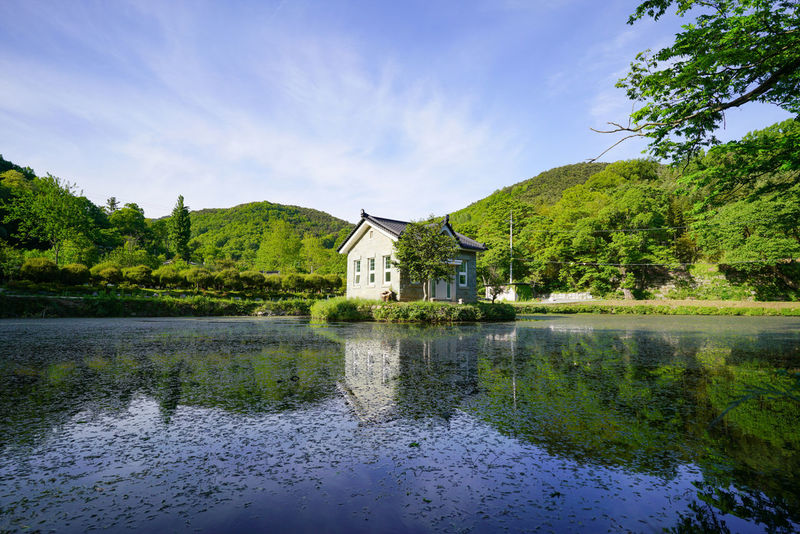 Reflection Water Building Exterior Architecture Lake Cloud - Sky Built Structure Flood Tree Extreme Weather Outdoors Sky No People Watermill Day Nature Beauty In Nature 여수스냅 광양스냅 순천스냅 Korea Hanguo