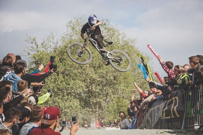 The Color Of Sport Sport Sports Photography Mountainbikelife Mountainbiking OurLifeStyle Leisure Activity Art And Craft Medium Group Of People Men Riding Mid-air Cloud - Sky Festival Crowd Canonphotography Madeby FlexoGrafie CyclingUnites