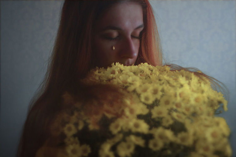 I gave her a bouquet with all the happiest tears I had Adult Blue Close-up Conceptual Conceptual Art Day Flower Hair Headshot Indoors  One Person Only Women Portrait Redhead Sad Tear Women Yellow Young Adult Young Women