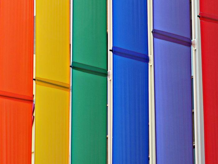 Full frame shot of rainbow flag on building
