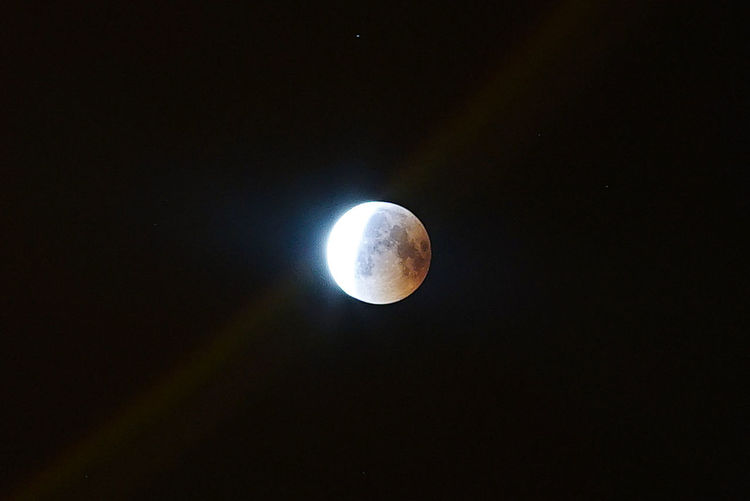 Astrology Astronomy Beauty In Nature Circle Dark Eclipse Full Moon Geometric Shape Low Angle View Moon Moon Surface Moonlight Natural Phenomenon Nature Night No People Outdoors Planetary Moon Scenics - Nature Science Sky Space Space And Astronomy Tranquil Scene Tranquility