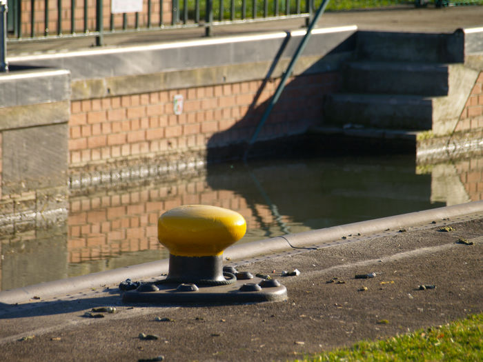 boat bollard Water Architecture No People Day Nature Sunlight Built Structure Outdoors Focus On Foreground Building Exterior Shadow Reflection Wall - Building Feature Yellow Connection Close-up City Lake Metal Bollard
