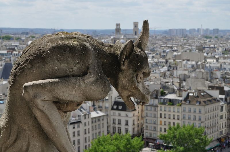 Close-up of sculpture against paris cityscape