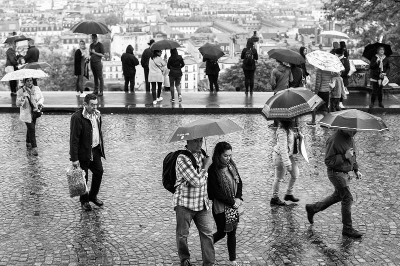 Rain in Paris. Adult Architecture Building Exterior Built_Structure Casual Clothing City City Life Crowd Day France Large Group Of People Leisure Activity Lifestyles Men Mixed Age Range Outdoors Paris Rain Real People Street Photography The Street Photographer - 2017 EyeEm Awards Walking Water Let's Go. Together. Connected By Travel