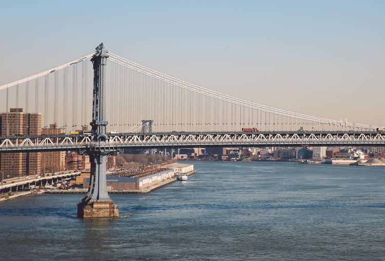 View of manhattan bridge in city