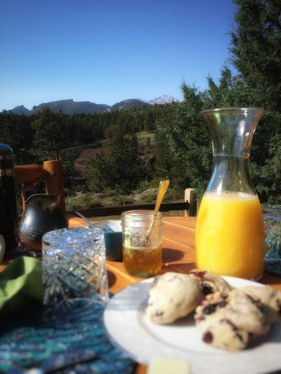 Longs Peak Breakfast Longs Peak Breakfast Outdoors Outdoor Meal Mountains Trees Blue Sky Orange Juice  Scones
